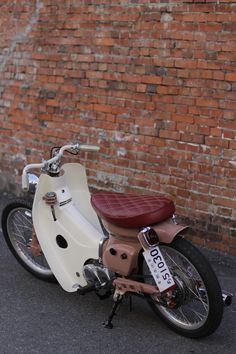 custom Honda Cub with maroon quilted seat