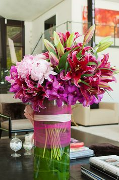 How gorgeous are pink lily blooms and buds when paired with peonies and orchids?