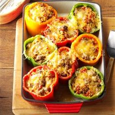 Mexican Stuffed Peppers Recipe -This nutritious yet economical summer meal makes the most of my home-grown peppers. I like to top it with sour cream and serve with tortilla chips and salsa, but it's wonderful on its own, too. —Kimberly Coleman, Columbia, South Carolina