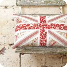 Rule Britannia. This Union Jack cushion can't be too hard to make -- it's all just layered angles and pretty florals.