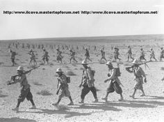 Italian infantrymen advancing by foot (due to the lack of motorization) in the desert in Libya. Summer 1940.