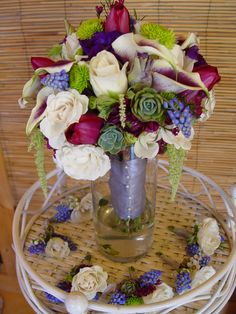Bride Bouquet And Boutonnieres @ Ocean song  Ivory roses, purple tulips, grape hyacinth, succulents, green hanging amaranthus, green button mums and picaso mini callas. Flowers and photo by The Wild Orchid floral design in Sebastopol.