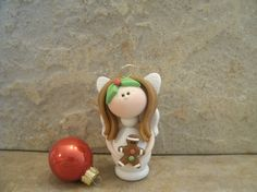 Angel and Gingerbread Man by countrycupboardclay on Etsy, $8.95- Awesome shop, I bought her christmas nativity and red fairy - i love her stuff!
