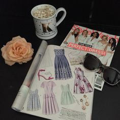 #whatsonmydesk • Garden Party Glam! @lovecultureofficial's floral dress as seen in @stylewatchmag plus our favorite @quayaustralia sunnies. And coffee, of course!