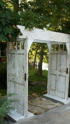 repurposed door arbour or gate into garden - so pretty!