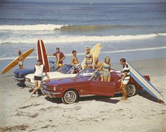 Friends with surfboards in car on beach Art Print by Tom Kelley Archive. All prints are professionally printed, packaged, and shipped within 3 - 4 business days.