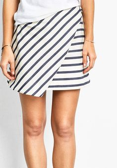"Basic Breton stripes get a modern update with our Athens wrap skirt. In a beautiful midweight cotton, showcasing contrasting stripes and a sleek side fastening. Tuck in a basic tee for a French-inspired look. •Wrap front, D-ring fastening. •Easy, straight fit. Try your usual size. •Mid rise, sits at your natural waist. •Lined. •Model is 5'9"" and wears size 10."