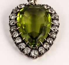 Victorian Peridot Diamond Silver Gold Pendant | From a unique collection of vintage drop necklaces at https://www.1stdibs.com/jewelry/necklaces/drop-necklaces/