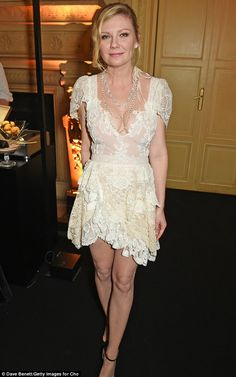 Here comes the bride:Kirsten Dunst flaunted her eye-catching diamond as she arrived at Ch...