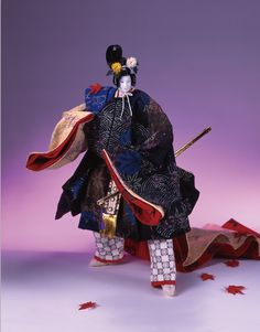 Kyoko Nakanishi doll. A man wearing kariginu