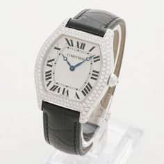 Our quite exceptional Cartier Tortue features a paved diamond rhodiumized 18k white gold case front, and a large diamond set into the octagonal crown. The new and unworn Cartier leather strap is fitted to a Cartier deployant 18k white gold buckle and the case back is sapphire, with visibility of the manual winding Cartier 430MC movement. This model is also known as the XL as it was in short production before the slightly smaller current model.
