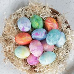 How to dye marbleized eggs by using shaving cream and food coloring. Substitute whipped cream for the shaving cream for edible eggs. #easter #eastereggs #dyeeggs #shavingcream