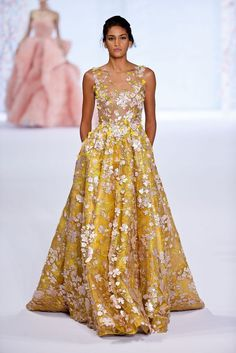 From butter tones to sunshine shades, these glowing, yellow wedding gowns will knock the socks off of your guests and the groom! Wow everyone as you make your way down the aisle in one of these designs!   via Pinterest Related