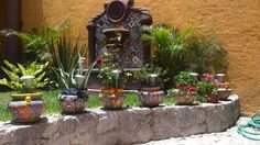 Spanish style wall mount stone fountain is decorated with talavera tiles. Both the cantera stone fountain ornaments and the tiles were handcrafted in Mexico. Stone Fountains, Pond Waterfall, Spanish Style, Water Garden, Water Features, Wall Mount, Rustic, Outdoor Decor, Plants