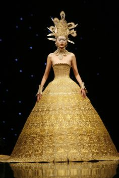 Guo Pei, gold lamé haute couture gown inspired by Chinese Buddhist iconography, courtesy of Guo Pei Rose Studio
