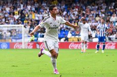 James Rodriguez of Real Madrid CF celebrates after scoring his team's second goal during the La Liga match between RC Deportivo La Coruna and Real Madrid CF at Riazor Stadium on September 20, 2014 in La Coruna, Spain.