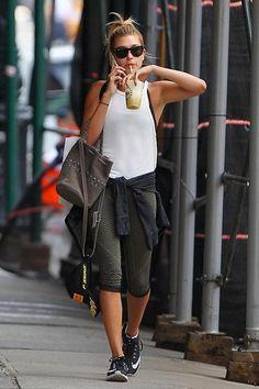 Hailey Baldwin wearing Pirello Podium Hat, AllSaints Estate Mini Bag in Caribou, Lululemon Heathered Fatigue Green Blk Chevron Crop and Nike Zoom Elite 7 Running Shoes