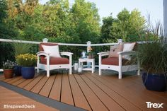 A beachy backyard retreat created with high-performance Trex Enhance Beach Dune and Clam Shell decking, Trex Transcend railing, and Trex Outdoor Furniture Rockport club chairs and end table. Find more inspirational outdoor living spaces at Trex.com. #InspiredDeck #sweepstakes