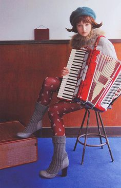 An accordion and nice patterned tights. ~ & the boots!