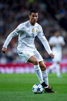 Cristiano Ronaldo of Real Madrid CF controls the ball during the UEFA Champions League Group A match between Real Madrid CF and Paris SaintGermain at...