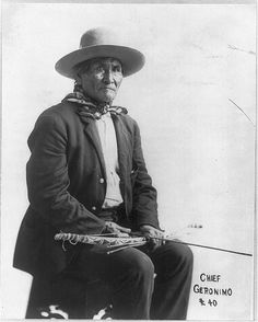 [Geronimo, Apache chief, 1829-1909, three-quarter length portrait, seated, with bow and arrow, facing right]