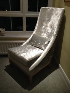 Wemyss Diva - a sort of wet look fabric - that looks stunning on this armless high back arm chair.