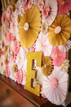 Gorgeous backdrop at a pink and gold first birthday party! See more party planning ideas at CatchMyParty.com!