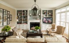 GREAT before and after. I LOVE this room. Built ins on either side of fireplace.