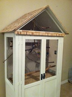 entertainment center turned bird cage-so Daniel can have his birds in the house and you don't have ugly cages to look at!!