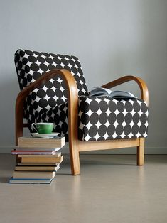 Black and white chair with wood base - so retro and adorable! #chair #black #white