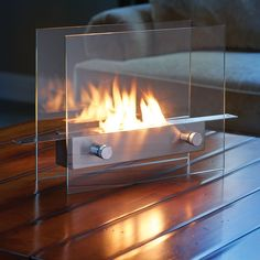 This is the liquid fuel fireplace that rests on any stable surface and provides the color, crackle, and comfort of a wood-burning fire without smoke, smells, or sparks.