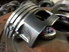 Bottle opener made from a car piston