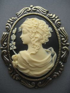 Romance - VIctorian Cameo Brooch / Necklace ...like the graceful flowing fabric of her dress...detailing of hair band.... another view from the back and pretty setting