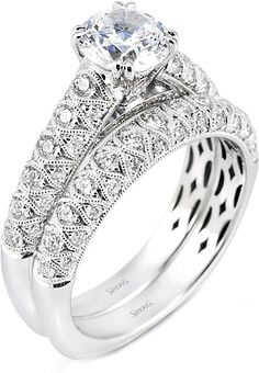 Simon G Pave Diamond Engagement Ring  : This Simon G diamond enagement ring has pave set diamonds going half-way around the band and will perfectly show off your choice of a center diamond.