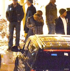 Paul Walker's friends, family and castmates embrace each other at the site of the actor's fiery crash.