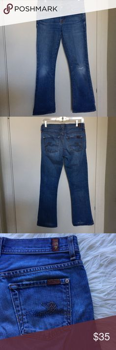 "7 For All Mankind Bootcut Jeans Size 26 7 For All Mankind bootcut jeans (style # U169162U- 162U). Lightly distressed light wash jeans with a slight flare. Waist is 26"" and the inseam is approx 29"".   For the most part, these are in good condition. The jeans have a hole at the knee on the left leg and one at the back of the of the leg because I wore jeans that were too long in the until I discovered skinny jeans (see photos). No longer remember if the hole at the knee was intentional by the…"