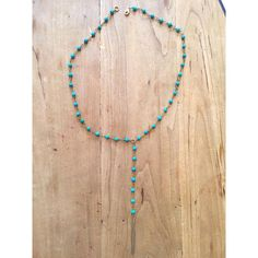 Turquoise beads with brass charm
