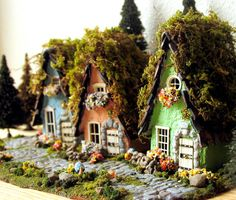 Miniature fairy houses made from polymer clay by Etsy seller bewilderandpine.