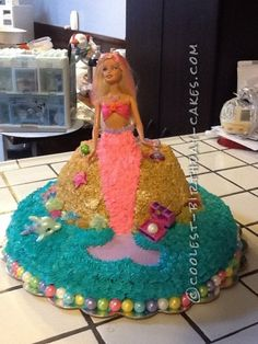 For the mermaid  cake you will need: yellow cake mix,  dark chocolate and triple fudge cake mix, butter cream icing, crushed toffee, gold crystals...