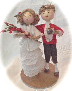 """Elizabeth and Darcy's Christmas.  This hand-made ornament stands 5"""" tall. Made of wire, wood, clay and paper. Her dress is made of vellum that is hand-cut and detailed to look like lace."""
