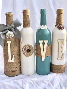 Wine Bottle Decor - DIY Crafts - Recycled wine bottles crafted with paint, twine, and letters to spell LOVE. These particular bottle - Old Wine Bottles, Recycled Wine Bottles, Wine Bottle Art, Glass Bottle Crafts, Painted Wine Bottles, Decorate Wine Bottles, Diy With Glass Bottles, Wine Bottles Decor, Crafts With Wine Bottles