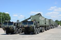 A group of heavy expanded mobility tactical trucks, or HEMTTs, are lined up to convoy to USAG Grafenwoehr. Army Vehicles, Armored Vehicles, Nurse Next Door, Tactical Truck, Cargo Transport, Deck Plans, Aircraft Design, Military Equipment, Car Brands