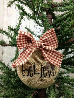 Fill a glass bulb with pieces of burlap, use a sharpie to add your wording. Finish off with a bow.