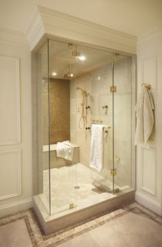 Beautiful Shower area with brass fixtures and golden tile wall | Regina Sturrock Design Inc