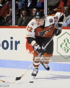 Rick Tocchet #22 of the Philadelphia Flyers skates against the Montreal Canadiens during the 1990's at the Montreal Forum in Montreal, Quebec, Canada.