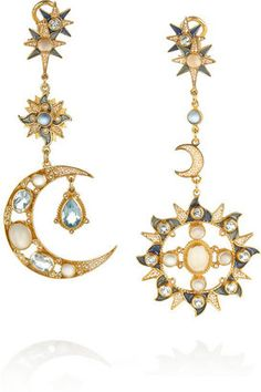 Symbols of the sun and moon transpire across the ages. Burning fire and cool stone. Light given and light taken. Bold and delicate. Above all is their celestial beauty. Percossi Papi Gold plated topaz moonstone and sapphire earrings. #sunearrings #moonearrings #moonstone #topaz #sapphire