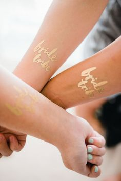 When we saw these tattoos on Etsy, we initially thought they were a bit much for a wedding. Bachelorette party sure, but an elegant affair not so much. Then we happened upon this pretty beach wedding captured by Dash Photographyand we changed out minds. What do YOU think about temporary tattoos for the bridal party?