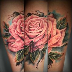 Rose tattoo by Copper Top Tattoos