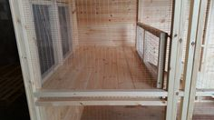Inside Of A 14x5x6.5ft Rabbit Kennel with Run, it has a shelf inside the run on the left with opening cover to make cleaning easier and it has three opening perspex windows. Stable door with an inner mesh door and two side rabbit doors, one to let rabbits into the run and the other to let them out to the garden or another run which will be added at some point in the future.