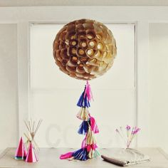 Use mini gold foils and handmade tassels to make this lantern.